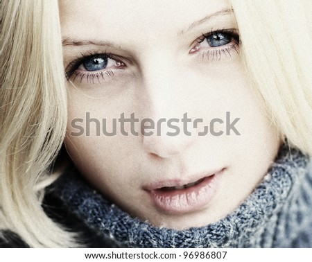 Portrait macro of young cute woman with blue eyes