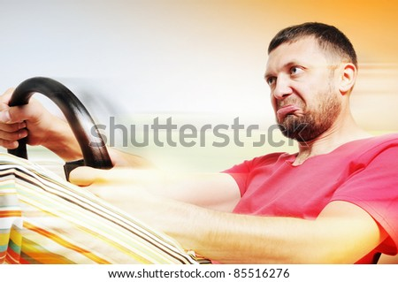 Portrait man of a driver fly at the speed, concept - stock photo