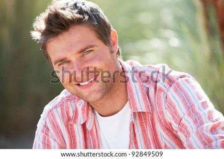 Portrait man outdoors - stock photo