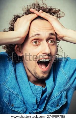 Portrait  man with a headache - stock photo