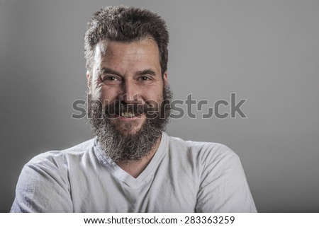 Portrait, man with full beard, smiling