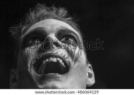 Portrait man with Halloween skull makeup. Halloween or horror theme