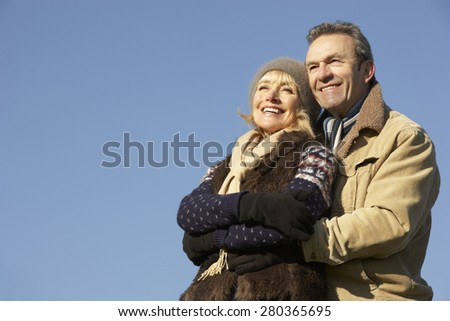 Portrait mature couple outdoors in winter - stock photo