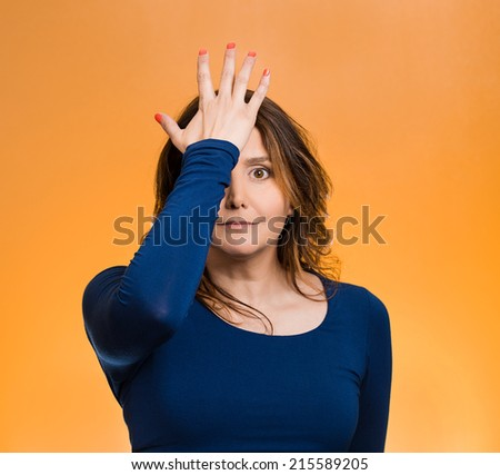 Portrait middle aged woman realizes mistake, slapping hand on head to say duh, isolated  orange background. Negative emotions, facial expression, feelings, body language,  - stock photo
