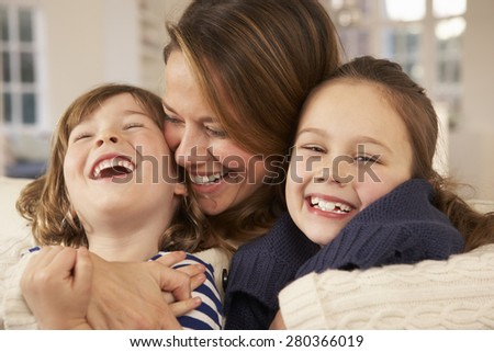 Portrait mother and children at home - stock photo