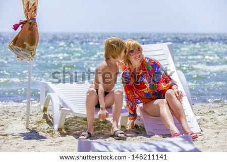portrait mother with son on sea - stock photo