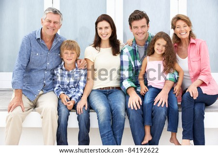 Portrait multi-generation family outdoors - stock photo