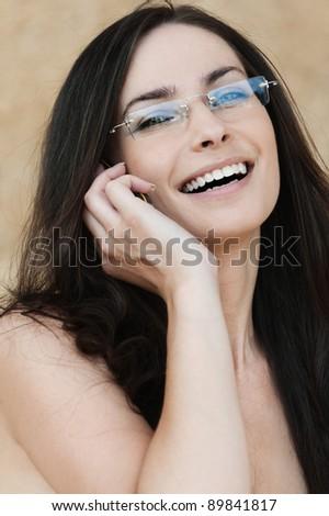 portrait naked brunette talking phone - stock photo