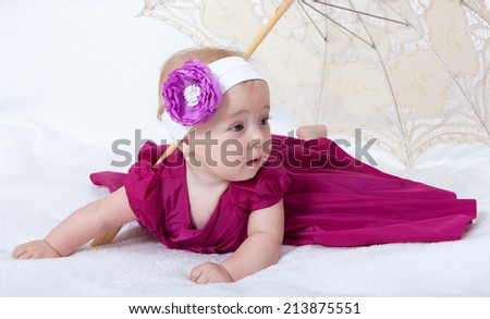 Portrait newborn baby lying in bed  - stock photo