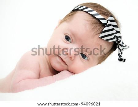 Portrait newborn baby lying in bed - stock photo