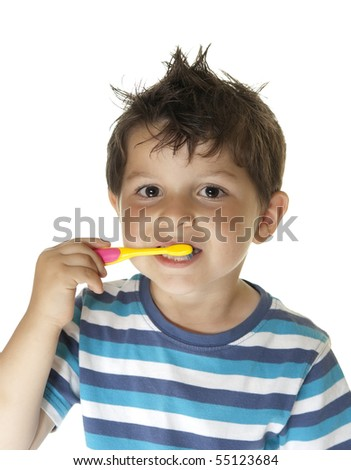 Portrait o a lovely child brushing his teeth