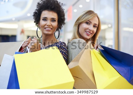 Portrait od two woman at the shopping mall - stock photo