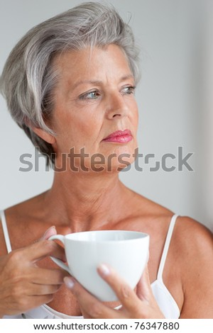 Portrait of a active senior woman with cup