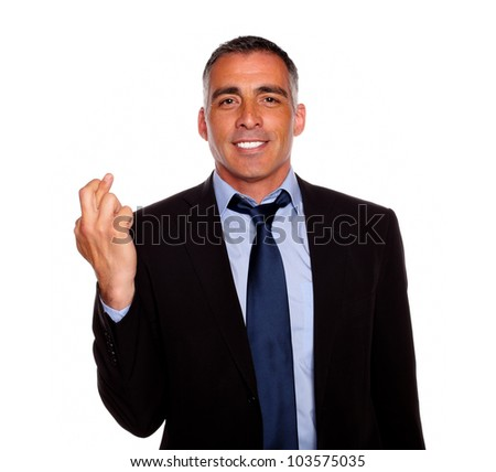 Portrait of a adult latin man crossing the fingers while wanting victory against white background - stock photo
