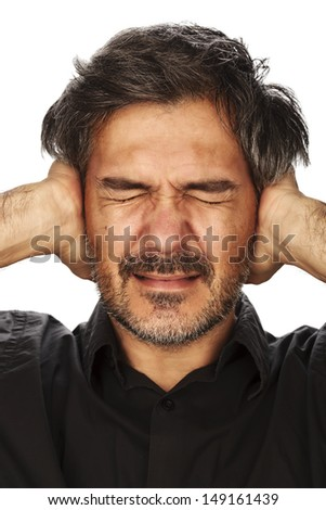 Portrait of a adult man covering his ears with hands. Studio shot, isolated on white background. - stock photo