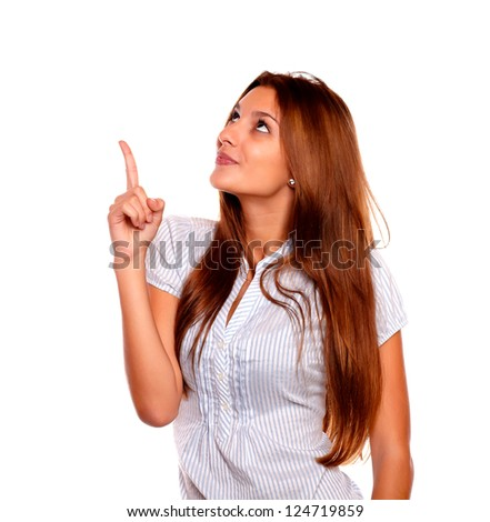 Portrait of a adult woman with long brown hair pointing and looking up copyspace on isolated background - stock photo