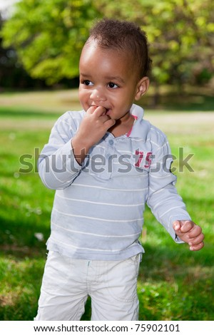 Portrait of a african american  baby boy playing  in the park