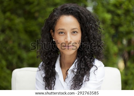 Portrait Of A African Woman Smiling At The Camera - stock photo