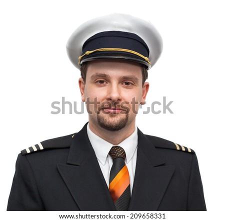 Portrait of a airline pilot - stock photo