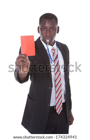 Portrait Of A An African Businessman Showing Red Card On White Background - stock photo