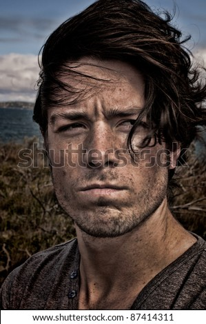 Portrait of a angry young man - stock photo