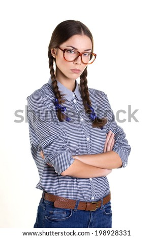portrait of a annoyed beautiful teens girl with big glasses in casual clothes isolated on white