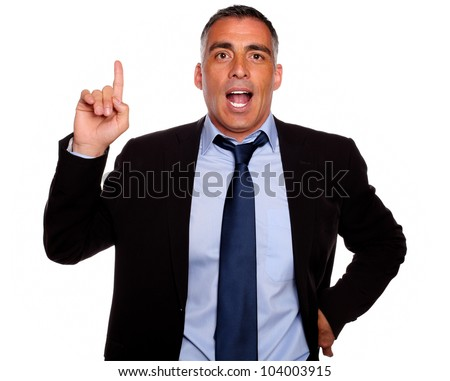 Portrait of a attractive executive speaking and pointing up on blue and black suit on isolated background - stock photo