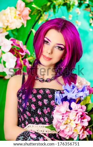 Portrait of a attractive girl among the flowers. Spring. Summer.