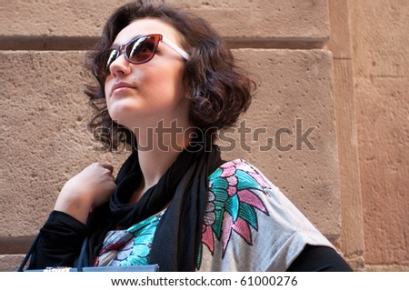 Portrait of a attractive girl, looking up - stock photo