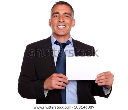 Portrait of a attractive man on suit smiling and holding a white card with copyspace on isolated background - stock photo