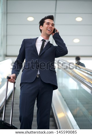 Portrait of a attractive young businessman talking on mobile phone - stock photo