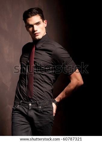 portrait of a attractive young male model serious attitude - studio shoot - stock photo