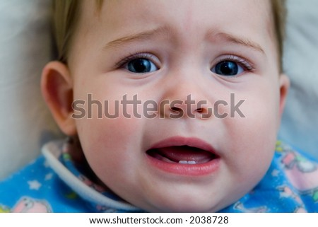 Portrait of a baby about to start crying - stock photo