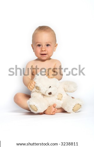Portrait of a baby boy sitting with a white teddy bear in his lap. Isolated on white background.