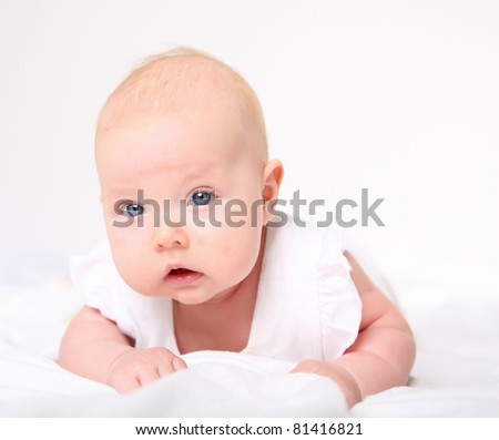 Portrait of a baby girl on a light background