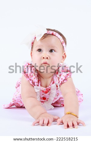 Portrait of a baby girl on a white background