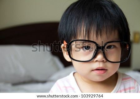 Portrait of a baby girl wearing big spectacles