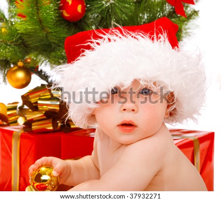 Portrait of a baby in a large Christmas hat - stock photo