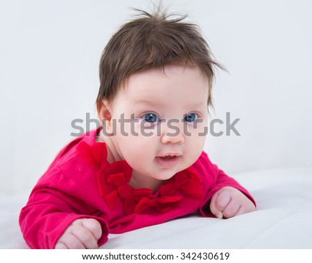 Portrait of a baby in a red jacket - stock photo