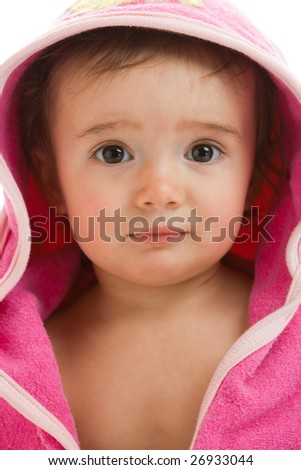 Portrait of a baby in pink hooded towel - stock photo