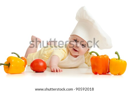 Portrait of a baby wearing a chef hat with healthy  food vegetables, isolated on white - stock photo