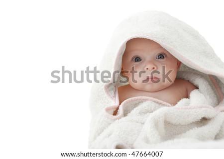 Portrait of a baby wearing a white bathrobe. - stock photo