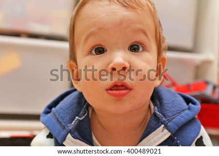 Portrait of a baby with a surprised look - stock photo