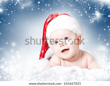 Portrait of a baby with Santa hat isolated on holiday background - stock photo