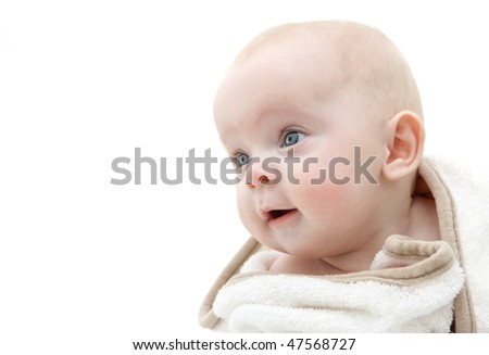Portrait of a baby wrapped in a white bath towel.