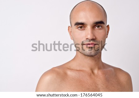 Portrait of a bald man. Bald Caucasian handsome man with topless shoulders. Close up.  - stock photo