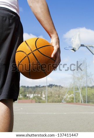 Portrait of a Basketball Player holding a basketball