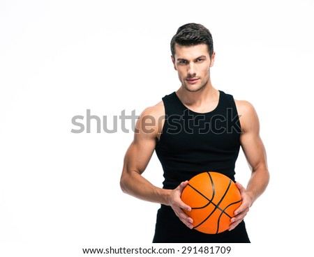 Portrait of a basketball player standing with ball isolated on a white background. Looking at camera - stock photo