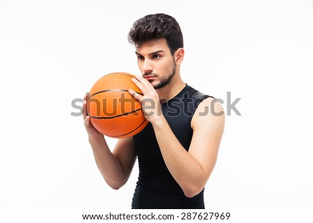 Portrait of a basketball player with ball isolated on a white background