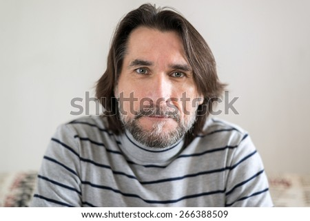 Portrait of a bearded middle aged men - stock photo